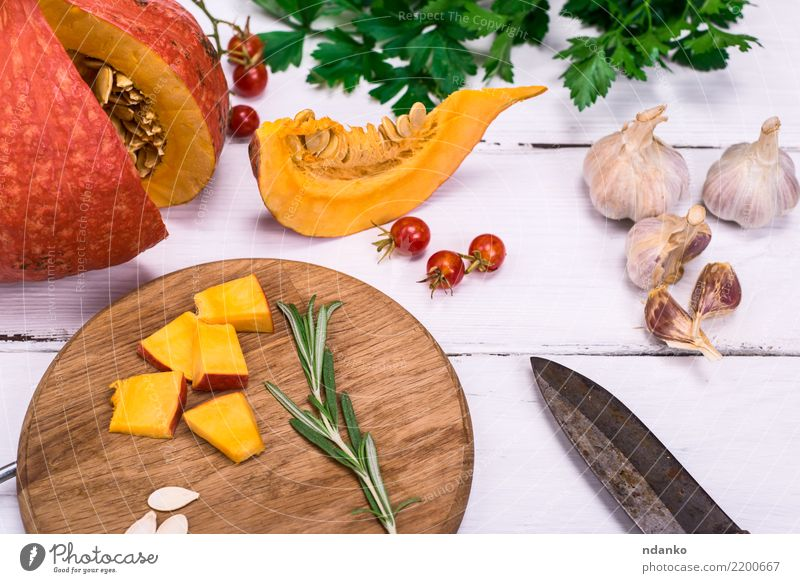 fresh slices of pumpkin Nature Eating Yellow Autumn Wood Decoration Fresh Table Vegetable Seasons Harvest Organic produce Tradition Dinner Knives Meal