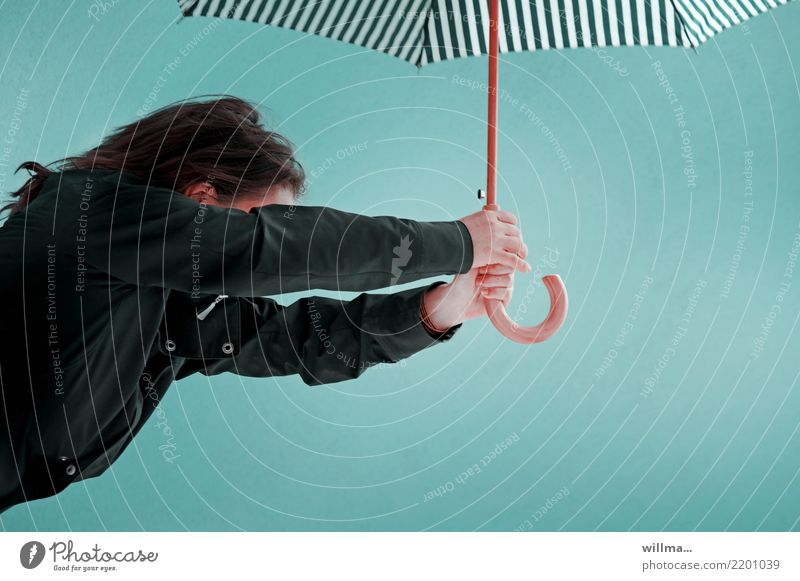 Woman with umbrella against a neutral background Adults 1 Human being Weather Gale Rain Umbrella Brunette Turquoise Striped Wind Upper body Copy Space