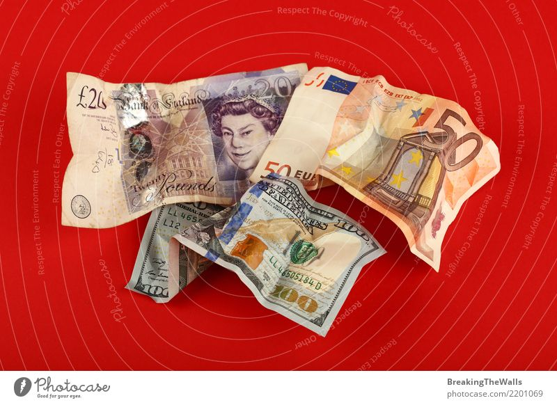 Rumpled banknotes of Euro, Dollars and Pound over red Red Business Dangerous Shopping Threat Money Risk Financial institution Economy Craft (trade) Trade Paying