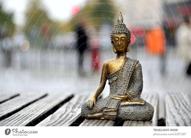 Small golden Buddha figure on a wooden bench in the city Harmonious Relaxation Calm Meditation Art Work of art Sculpture Downtown Pedestrian precinct Places