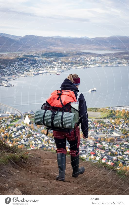 Young woman on her way to Tromsø Vacation & Travel Far-off places Hiking Youth (Young adults) Life Mountain Fjord Port City Downtown Discover Natural Uniqueness
