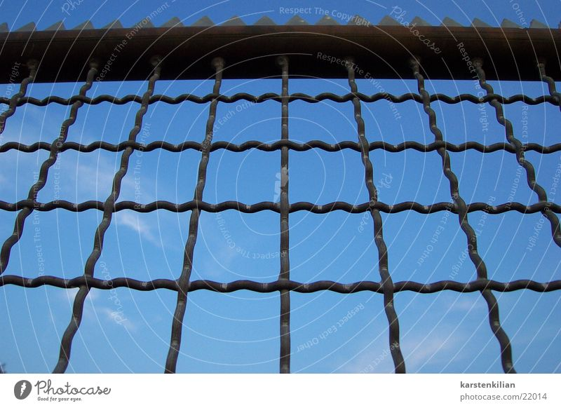 Sky Blue Clouds Metal Protection Obscure Fence Barrier Close Grating Prongs Wire netting Surround