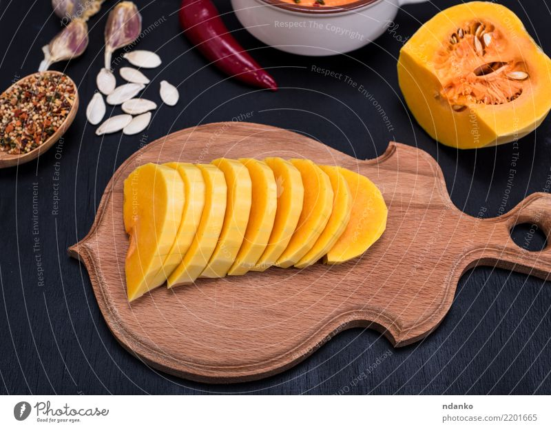 fresh pumpkin sliced into pieces Nature Black Eating Yellow Autumn Wood Fresh Table Vegetable Seasons Harvest Organic produce Tradition Dinner Meal
