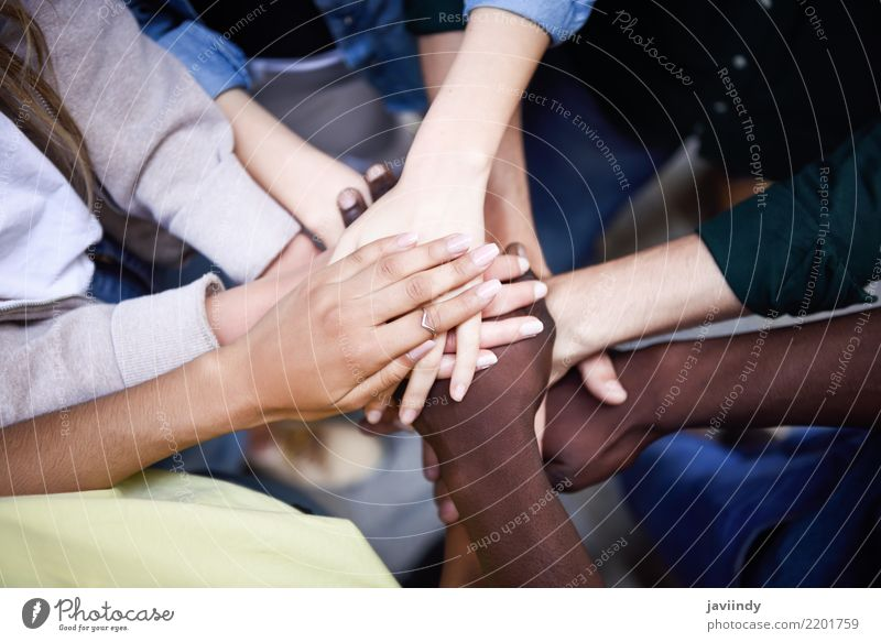 Multiracial young people putting their hands together Woman Human being Youth (Young adults) Man White Hand 18 - 30 years Black Adults Lifestyle Group Together