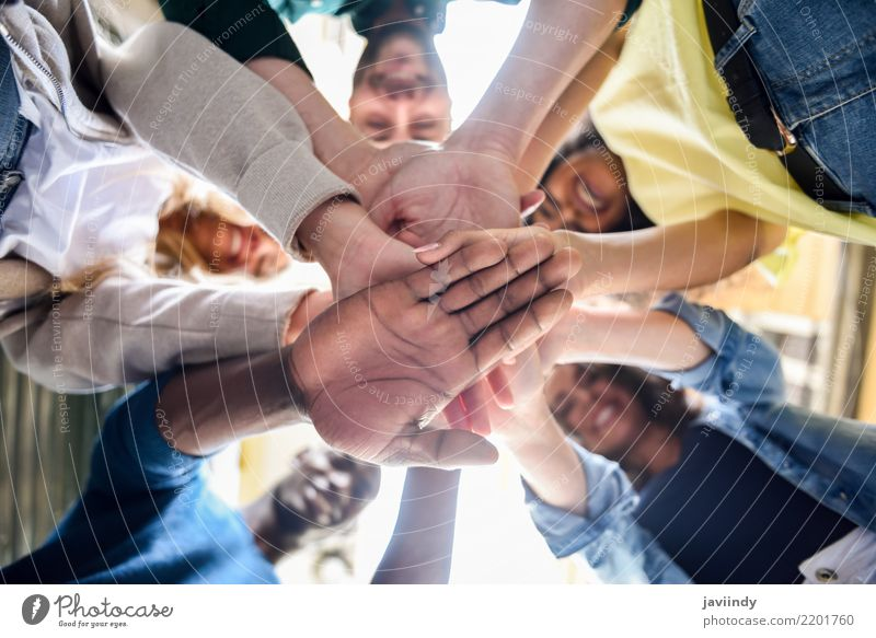 Close up view of young people putting their hands together. Academic studies Human being Woman Adults Man Friendship Hand Group Suit Together Black White Power