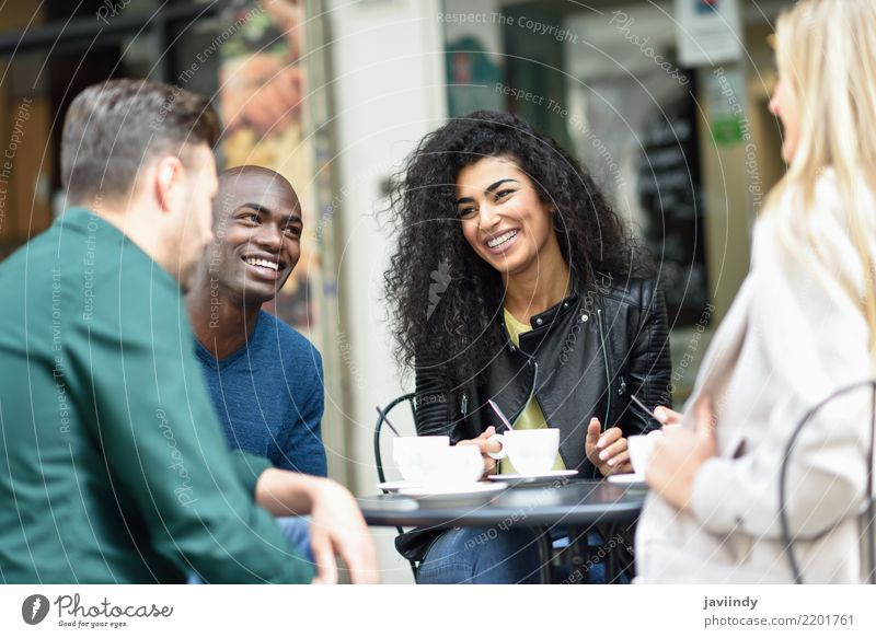 Multiracial group of four friends having a coffee together. Woman Man Summer Beautiful Joy Adults Lifestyle To talk Laughter Happy Group Together Friendship