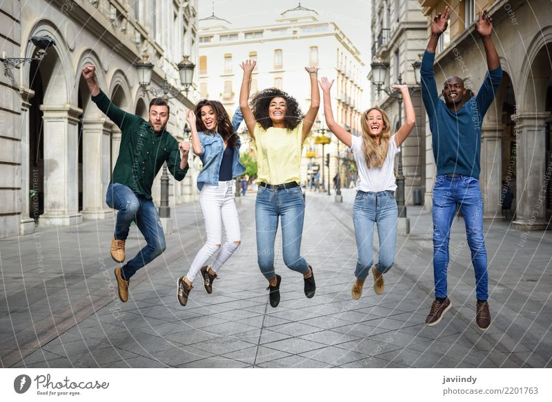 Multiracial group of people jumping together Woman Man Summer Beautiful Joy Adults Street Lifestyle Laughter Happy Group Together Friendship Jump Smiling