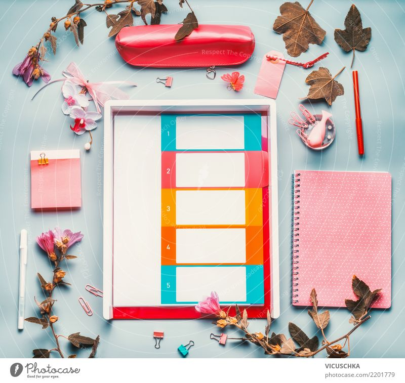 Desk with accessories and flowers Lifestyle Style Design Academic studies Office work Business Feminine Stationery Paper Piece of paper File Blue Pink White