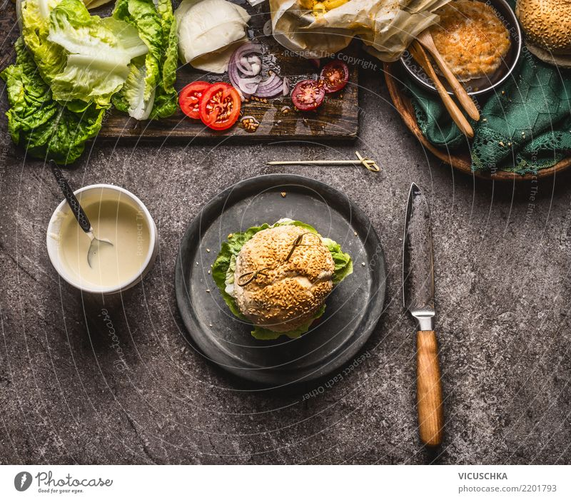 Homemade burger on the plate with knife and ingredients Food Meat Cheese Vegetable Lettuce Salad Roll Nutrition Lunch Fast food Crockery Style Design Restaurant