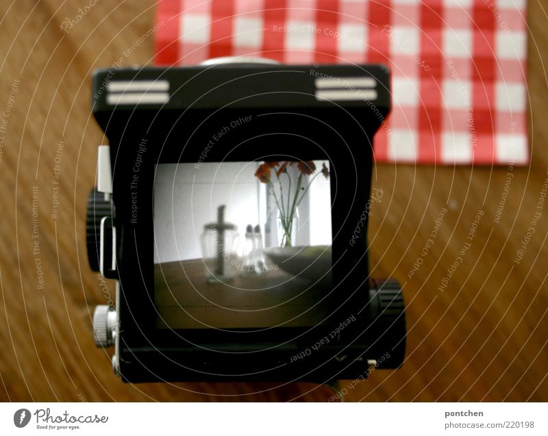 Things stand on wooden table. View through an analog medium format camera Living or residing Furniture Table flowers Bowl Glass Red Black White Medium format