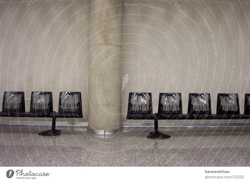 Black Cold Gray Room Wait Architecture Airport Concrete Bench Column Row of seats Sterile Departure lounge Impersonal Concrete wall Waiting area