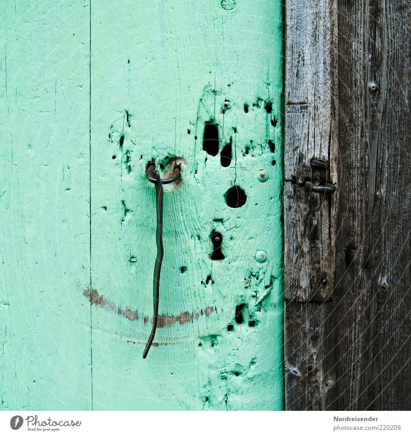 Old Green Metal Door Open Past Lock Grinning Hollow Whimsical Smiling Checkmark Smiley Door lock Closure