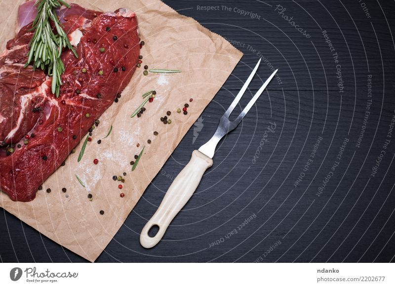 piece of raw beef Meat Herbs and spices Dinner Fork Table Kitchen Paper Wood Eating Fresh Green Red Black Meal pepper Beef Chop Organic salt Gourmet Raw