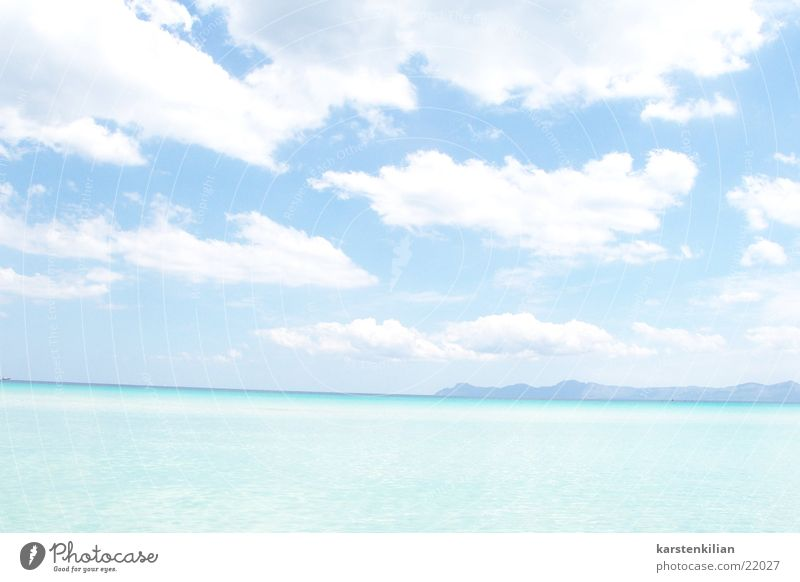 Ocean Blue Clouds Far-off places Warmth Coast Vantage point Physics Turquoise Bad weather Sea water