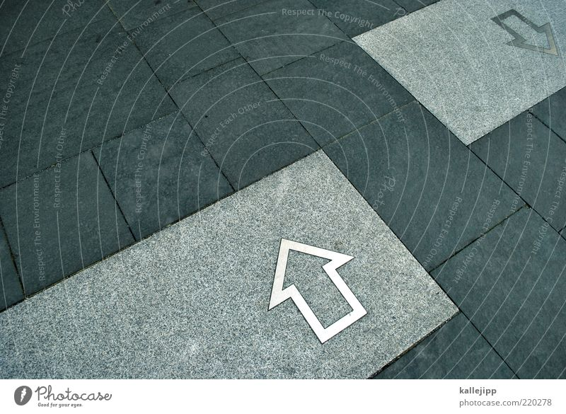 Above Gray Stone Arrow Sign Arrow Under Direction Against Navigation Left Converse Paving stone Right Orientation