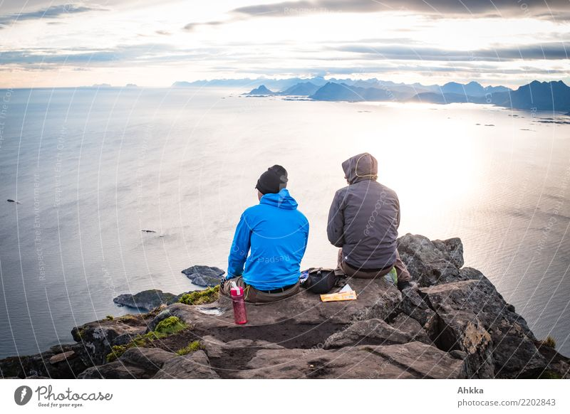 Summit photo of two young men over the North Sea, Lofoten Ocean Island Young man Youth (Young adults) Life 2 Human being Landscape Peak Lofotes Authentic Free