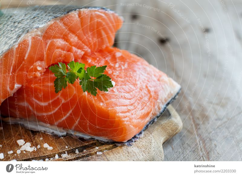 Fresh raw salmon on a wooden cutting board Fish Seafood Nutrition Eating Dinner Diet Table Green Red background cooking fillet healthy Ingredients Meal Portion