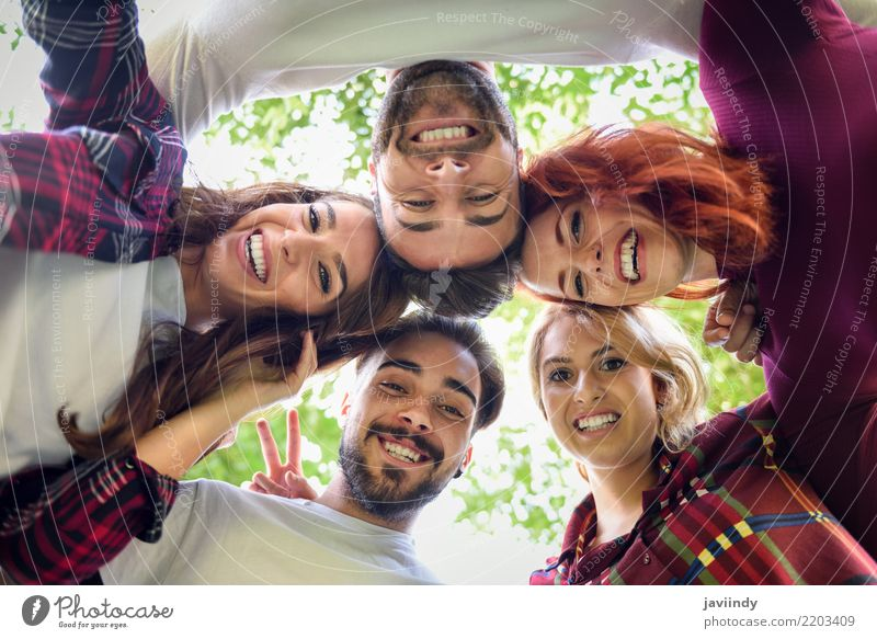 Group of young people together outdoors in urban background. Woman Man Beautiful Joy Adults Street Lifestyle Autumn Laughter Happy Together Friendship Smiling