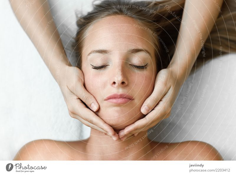 Young blond woman receiving a head massage in a spa center Woman Human being Beautiful Hand Relaxation Face Adults Lifestyle Health care Happy Blonde Skin