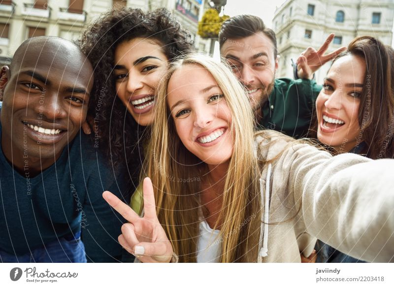 Multiracial group of friends taking selfie in a urban street with a blonde woman in foreground Lifestyle Joy Leisure and hobbies Vacation & Travel Human being