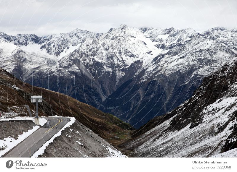 Sharp corner Calm Winter Snow Mountain Landscape Alps Peak Street Tall Loneliness Curve Pass Virgin snow Valley Sölden Ötz Valley Vantage point Austria