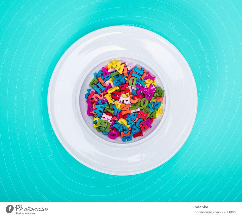 round plate and colored wooden letters Blue Green White Red Yellow Wood Pink Above Nutrition Idea Information Education Word Plate Text Top