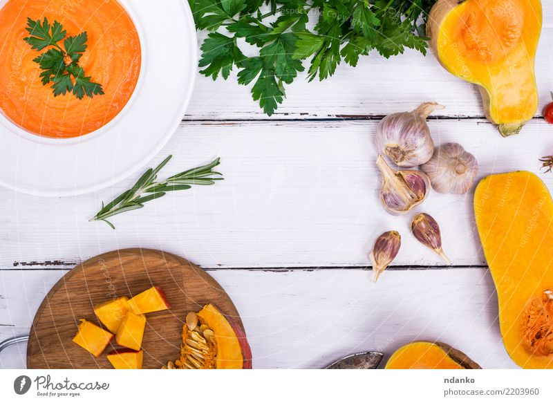 pumpkin soup in a white plate Nature Dish Eating Yellow Autumn Wood Nutrition Decoration Fresh Table Herbs and spices Kitchen Vegetable Seasons Harvest Hot