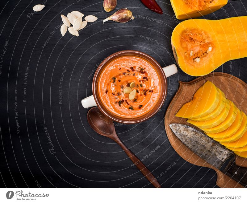 cream fresh pumpkin soup Vegetable Soup Stew Herbs and spices Eating Lunch Dinner Organic produce Vegetarian diet Bowl Spoon Decoration Table Hallowe'en Nature