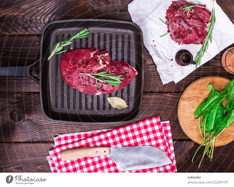raw beef steak Food Meat Herbs and spices Dinner Pan Knives Table Kitchen Paper Wood Fresh Green Red background Beef Blood board butcher Chop close cooking Cut