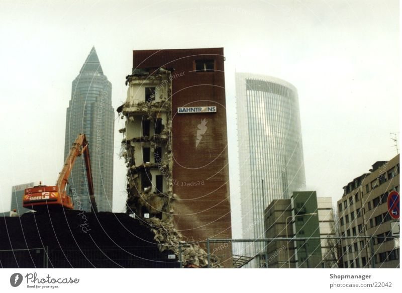 Frankfurt in upheaval Dismantling Smog Exebition centre High-rise Building rubble Rip Destruction Annihilate Excavator Architecture Graffiti
