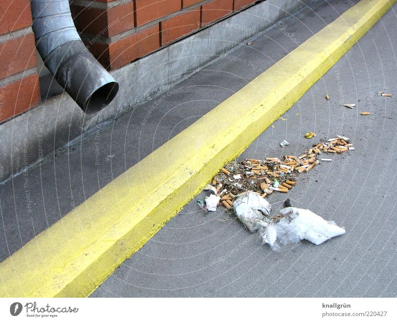 legacies Wall (barrier) Wall (building) Drainpipe Dirty Yellow Gray Environmental pollution Trash Lane markings Colour photo Exterior shot Deserted Day