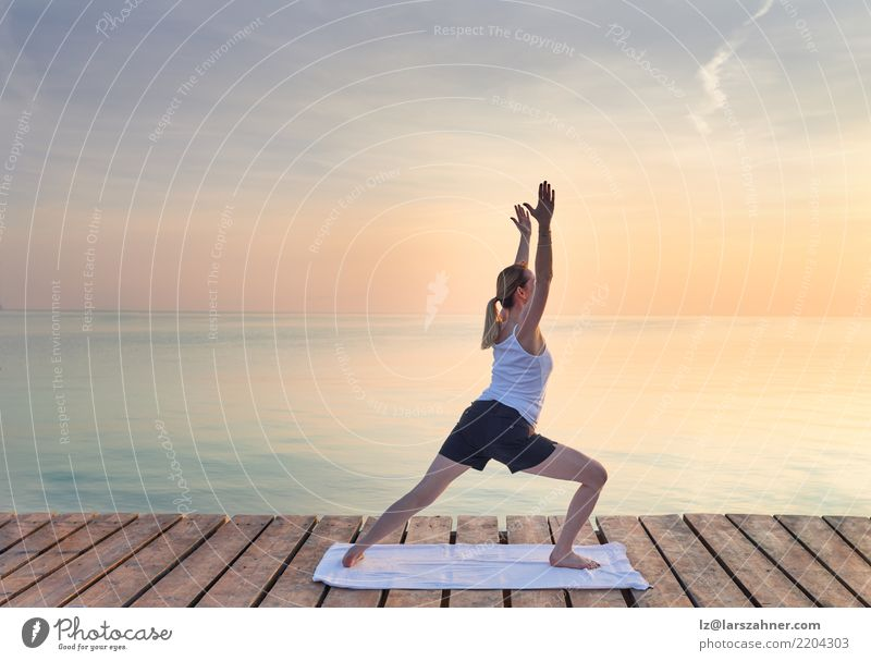 Young woman practicing yoga by sea Woman Human being Vacation & Travel Summer Ocean Relaxation Adults Copy Space Blonde Power Stand Energy Wellness Serene