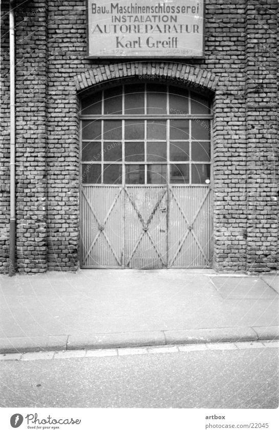 Karl Greif's workshop Retro Workshop Past Auto repair shop Craft (trade) Square Brick Historic Gate garu Black & white photo Old Metal Loneliness Former