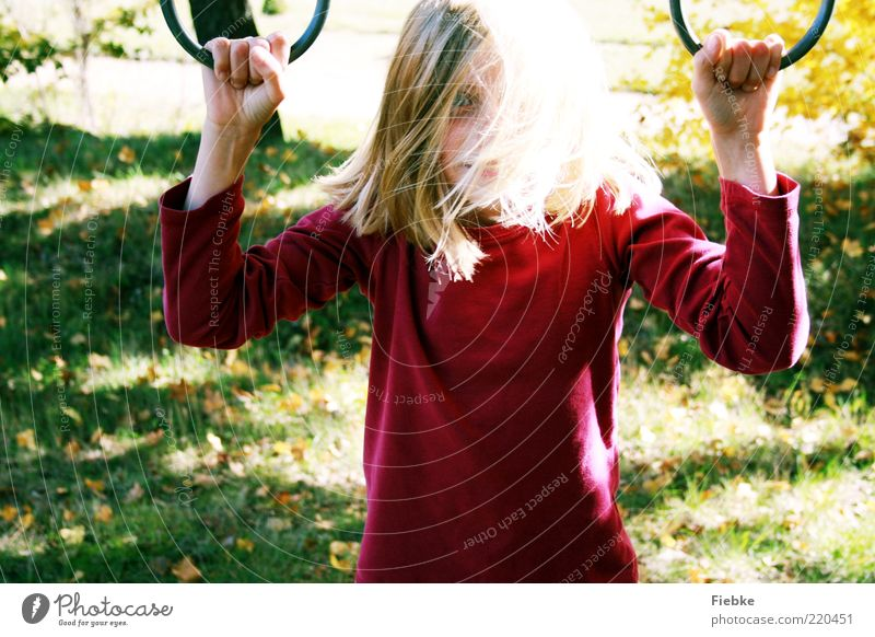 autumn child Playing Child Girl Infancy 1 Human being 8 - 13 years Nature Autumn Beautiful weather Grass Meadow Sweater Blonde Long-haired To enjoy Illuminate