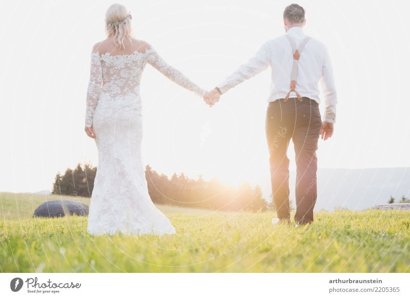 Young wedding couple at sunset Beautiful Feasts & Celebrations Wedding Human being Masculine Feminine Young woman Youth (Young adults) Young man Couple Partner