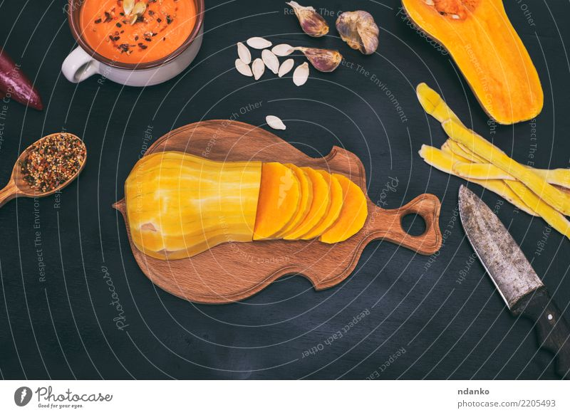 pumpkin on a wooden kitchen board Nature White Dish Black Eating Yellow Autumn Natural Wood Nutrition Decoration Fresh Table Herbs and spices Kitchen Vegetable