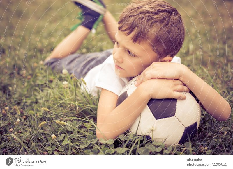 Portrait of a young boy with soccer ball. Child Human being Man Summer Green Relaxation Joy Adults Lifestyle Movement Sports Grass Family & Relations