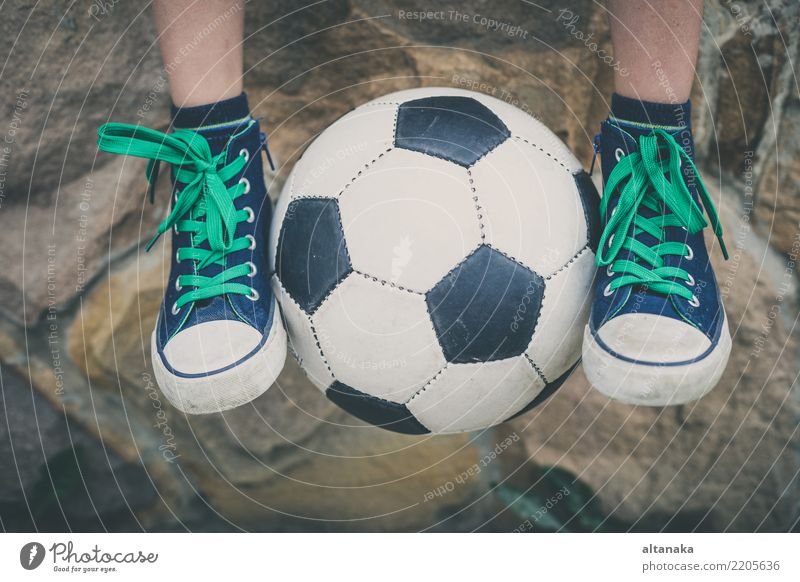 Young little boy sitting with soccer ball. Lifestyle Joy Happy Relaxation Leisure and hobbies Playing Summer Sports Soccer Child School Human being Boy (child)