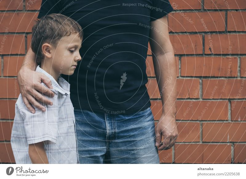 Portrait of young sad little boy and father sitting outdoors at the day time. Concept of sorrow. Face Child Boy (child) Man Adults Parents Father