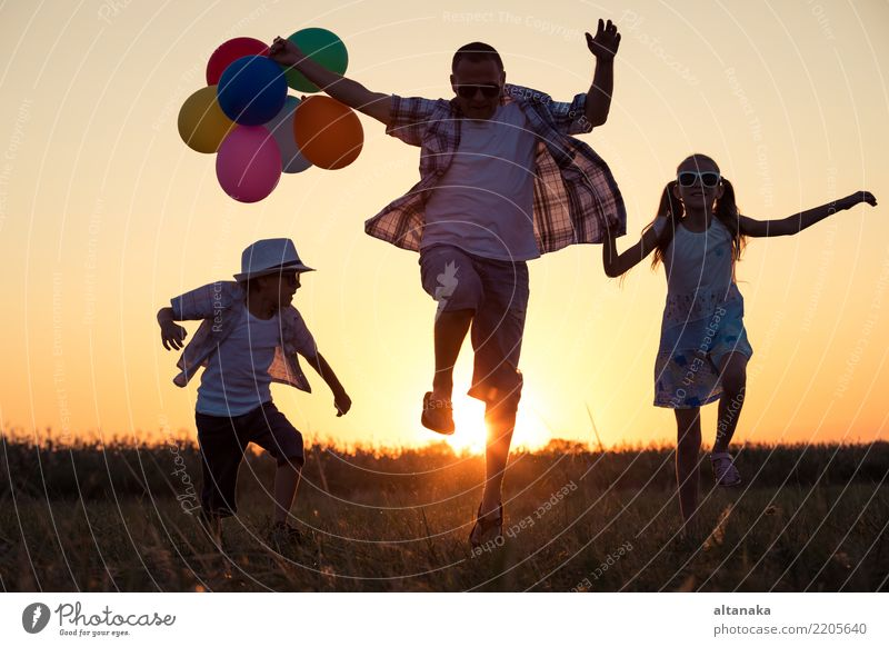 Father and children running on the road Lifestyle Joy Happy Leisure and hobbies Vacation & Travel Adventure Freedom Camping Summer Sun Sports Child Human being