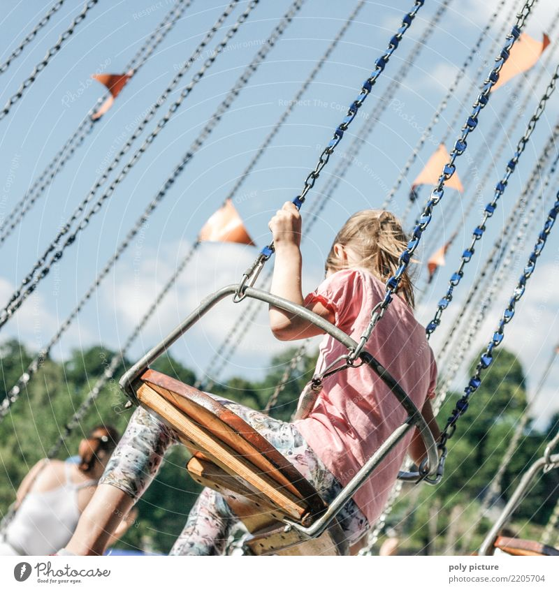 Young girl driving a chain carousel Lifestyle Joy Happy Fitness Harmonious Contentment Relaxation Vacation & Travel Summer Summer vacation Sun Event