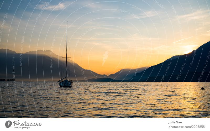 Sunrise on Lake Como with a boat on the water lago the como Water Italy Mountain Alps Morning Sunbeam Dawn Fog Panorama (View) Panorama (Format) Vantage point