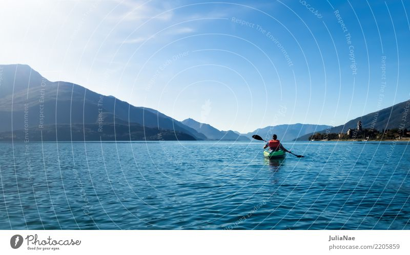 Paddling on Lake Como Como province db Italy Water Calm Watercraft Canoe Driving boating Human being on one's own Mountain Blue Vacation & Travel voyage