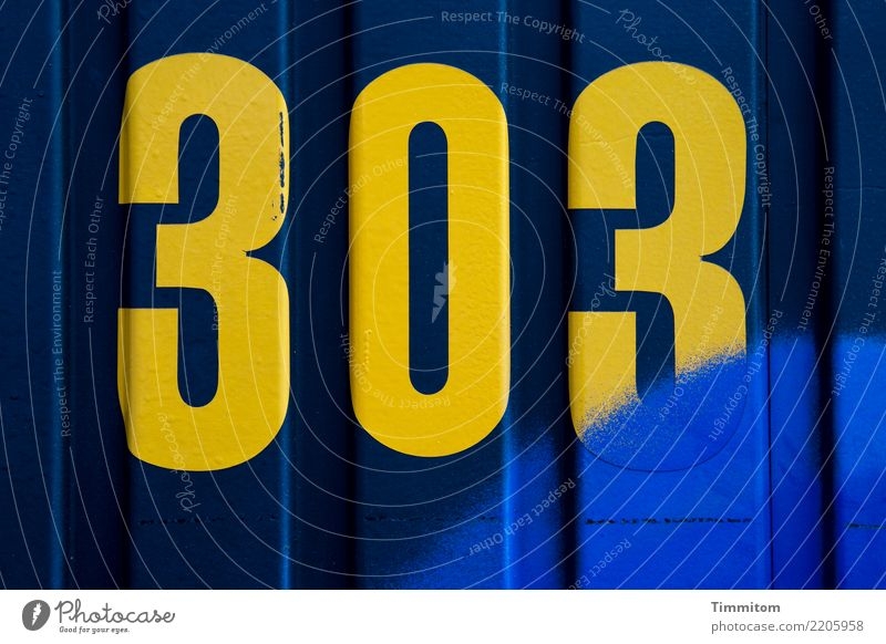 303 yellow on blue plus extra blue. Site trailer Digits and numbers Line Blue Yellow Arrangement 300 Dye Sprayed Lettering Exterior shot Light Shadow