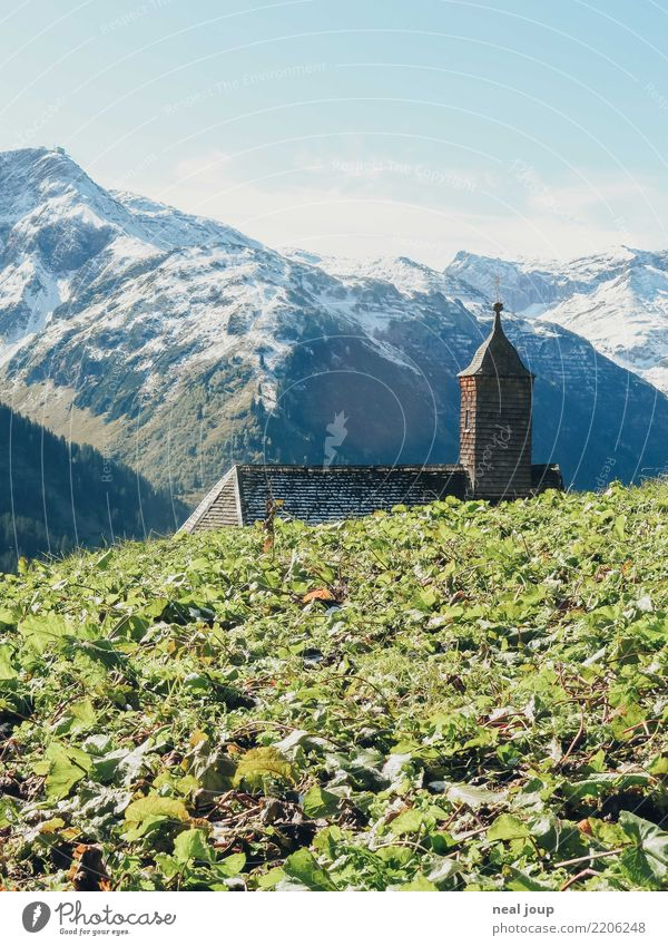 Chapel with view Landscape Horizon Mountain Snowcapped peak Austria Roof Tower Crucifix Discover Hiking Simple Historic Tall Small Cliche Blue Green Virtuous