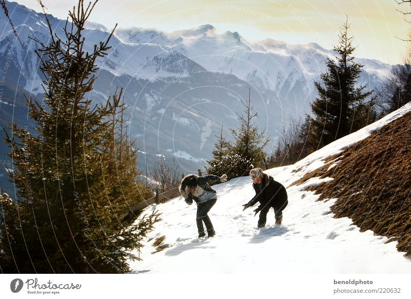 Lovers at snowball fight Joy Happy Well-being Leisure and hobbies Tourism Trip Winter Snow Winter vacation Mountain Hiking Young woman Youth (Young adults)