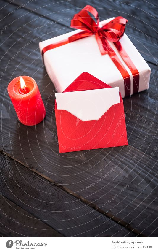 Stylish present and empty red letter Elegant Handcrafts Feasts & Celebrations New Year's Eve Birthday Package Cute Surprise above view candlelight christmas