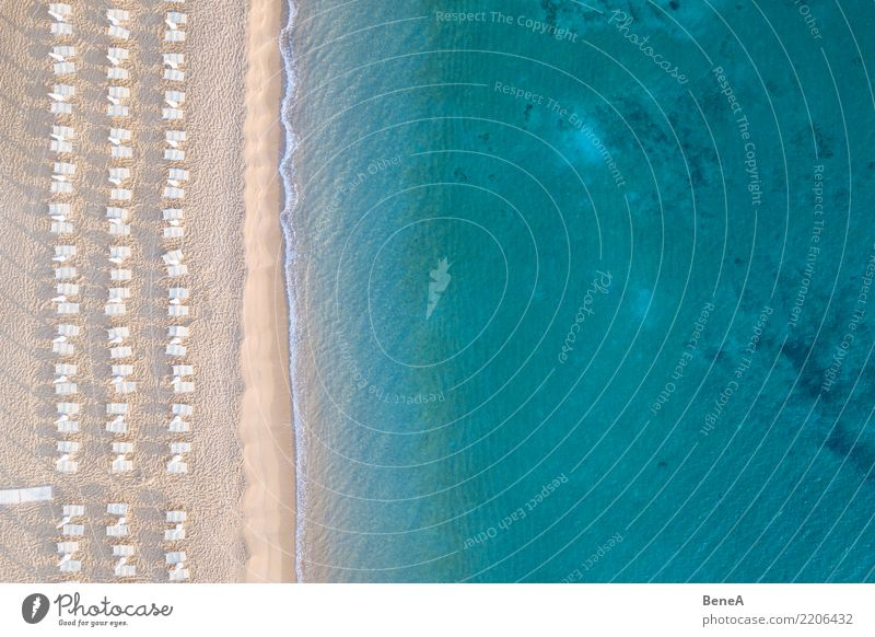 Deckchairs on a sand beach at the turquoise blue sea from above Lifestyle Exotic Relaxation Swimming & Bathing Vacation & Travel Tourism Trip Adventure