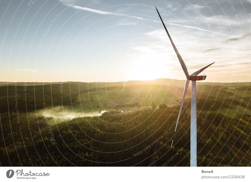 Wind turbine in a forest at sunset from above Economy Industry Energy industry Technology Advancement Future High-tech Renewable energy Wind energy plant Nature