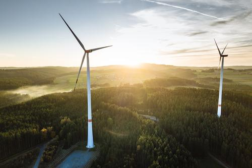 Wind farm in the forest at sunset from above Industry Energy industry Technology Advancement Future High-tech Renewable energy Wind energy plant Nature Sky